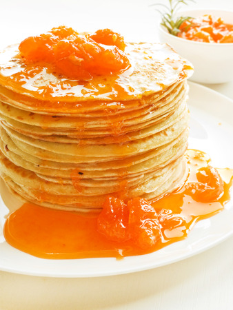 Stack of pancakes with clementine jam. Shallow dof. Stock Photo