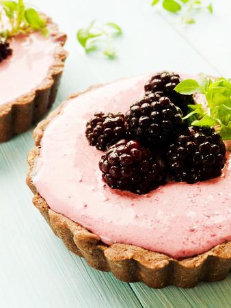 Tarts with cheese and fresh blackberries dessert. Shallow dof.