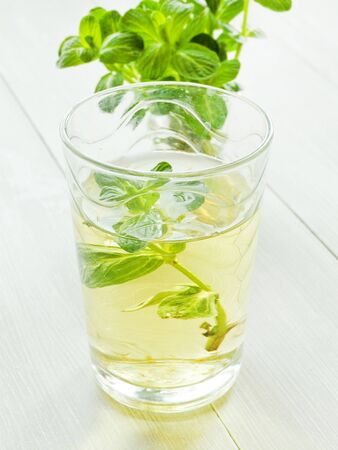 Mint tea on wooden background. Shallow dof.