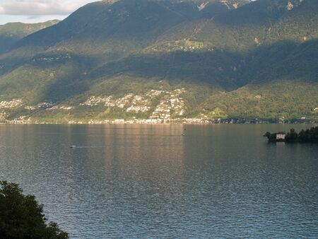 regeneration: View on lake maggiore at daytime with the mountains in the background