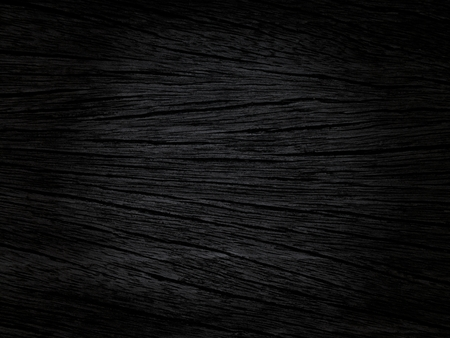 edited photo: Dark Wood Background; photo taken of a surface and edited to a dark and sullen background, useful for different applications