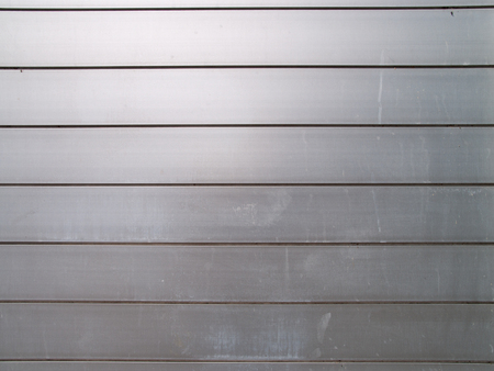 rustproof: Wall made of metal plates, a little dirty and weathered, useful as background
