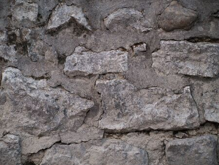 man made: Front view and close up of a man made wall with stones