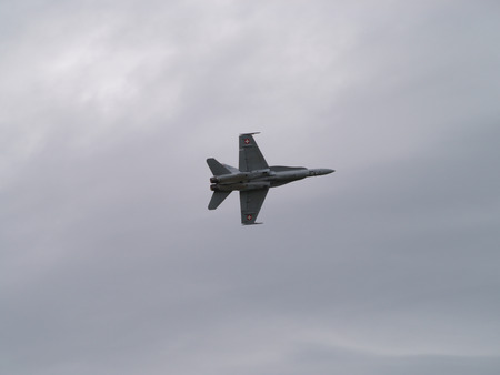 F / A-18 Hornet fighter jet from the swiss air force in action during the 75th anniversary of the swiss anti-aircraft defense forces in Duebendorf, Switzerland, on june 25th 2011