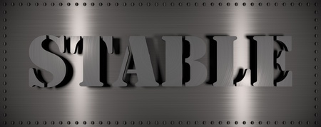 Brushed steel plate with rivets around it and the word