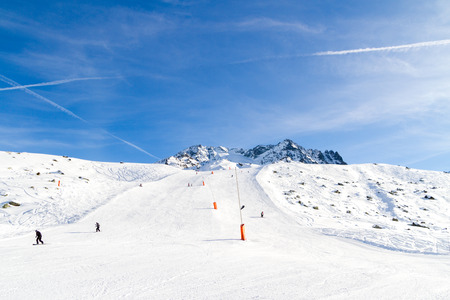 val: downhill skiing, snow-capped mountains,  Val Thorens,  France Stock Photo