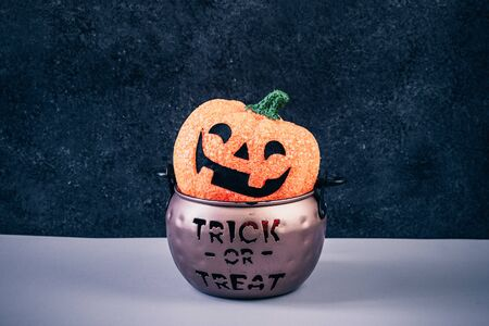 Happy Halloween Day, Spooky day. Pumpkin trick or treat basket, orange pumpkins, scary metal house