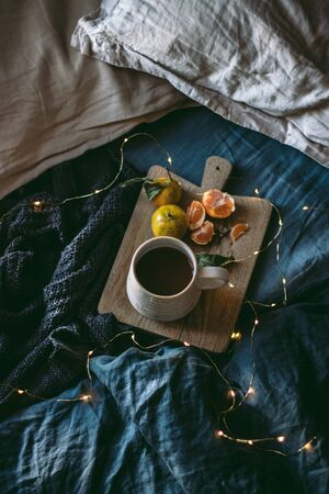 Cozy time at home with cup of coffee on a Autumn season. Hot cacao or coffee in a cup. Autumn and winter drink at home.