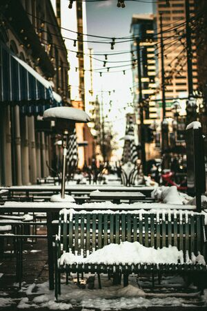 Snow and sunny day in Denver city. Downtown streets with snow. Financial district on a snow day.