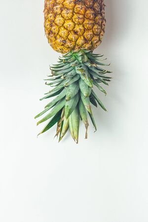 Yellow juicy fresh pineapple on a minimalist background