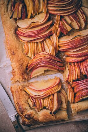 Autumn apple puff pastry tart with cinnamon spice and honey drizzle. Comfort Fall baking food. 免版税图像