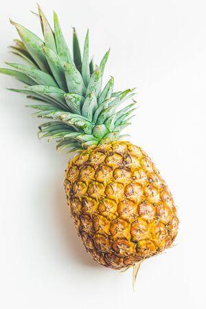 Yellow juicy fresh pineapple on a minimalist background