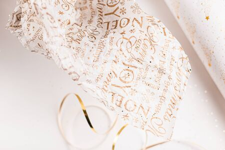 Gift wrapping. Festive wrap paper for Christmas, New Years Eve celebration. White, golden, silver festive colors. Holiday season. Handmade gift box packing.