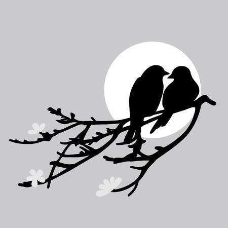 2 羽の鳥が枝に座っています。
