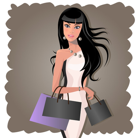 Young woman with shopping bags on a gray background