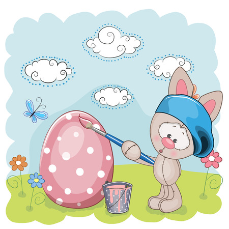 Cute Rabbit with brush is colored an egg Vector