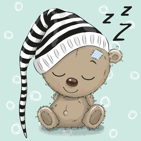 Sleeping cute Teddy Bear in a hood on a blue background
