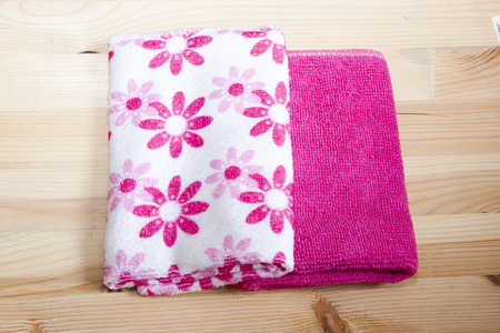 household goods: Household goods - rags for cleaning, bathing and cleanliness on wooden background.