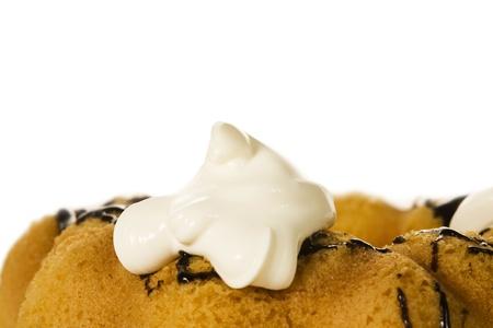 dough nut: dairy cream on dough nut. Stock Photo