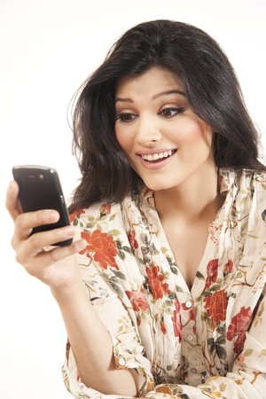beautiful Indian girl using cell phone photo