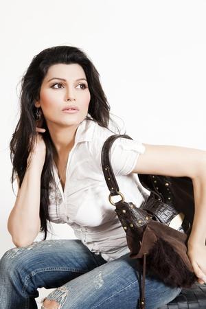 beautiful indian girl holding hand bag Stock Photo - 9855885