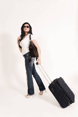 carrying girl: glamorous Indian girl leaving for journey and boarding on a plane.