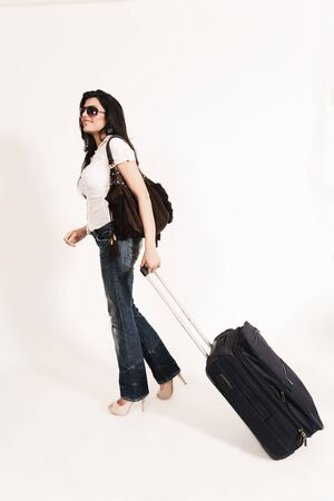glamorous Indian girl leaving for journey and boarding on a plane. photo