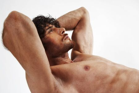 semi nude portraits of a handsome muscular man