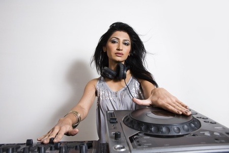 pakistani females: Indian Female Dj shot against white Back ground In studio. Stock Photo