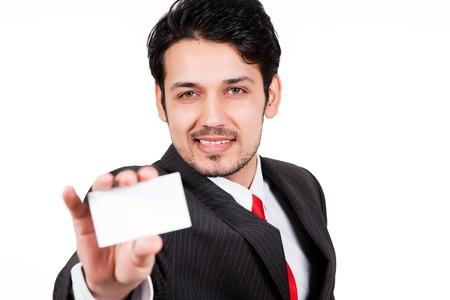 portrait of arab businessman holding visiting card