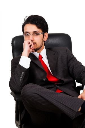 worried businessman: portrait of a worried businessman sitting on office chair Stock Photo