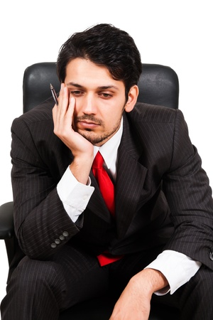 portrait of a worried businessman sitting on office chair photo