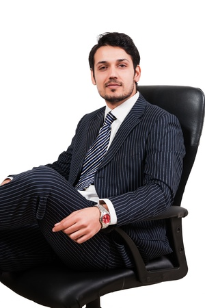 man in chair: portrait of a confident Arab businessman sitting on a chair, biracial businessman isolated on white