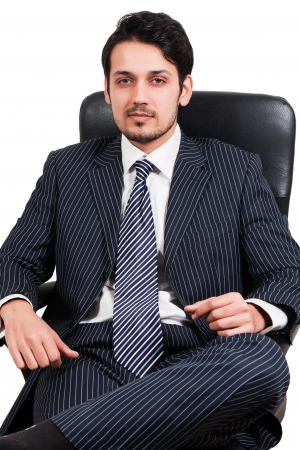 portrait of a confident Arab businessman sitting on a chair, biracial businessman isolated on white photo