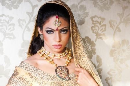 nude bride: portrait of a beautiful Indian bride