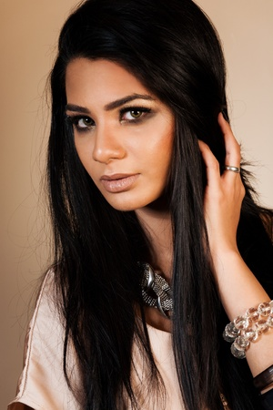 beauty shot of attractive mixed race female fashion model  photo
