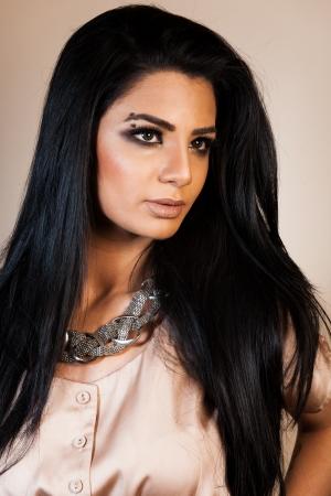 beauty shot of attractive mixed race female fashion model  photo