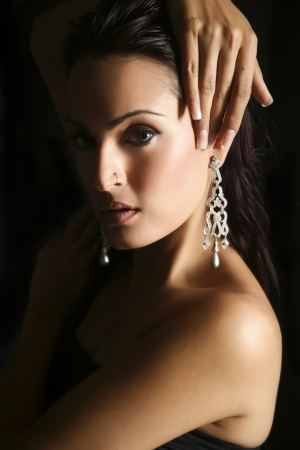 earing: female fashion model wearing traditional Indian Jewellery Stock Photo