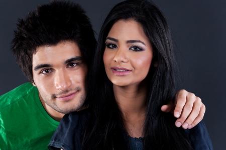 portrait of ethnic couple couple in studio, latin american man with Indian girl Stock Photo - 14221419