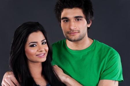 portrait of ethnic couple couple in studio, latin american man with Indian girl photo