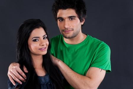 indian couple: portrait of ethnic couple couple in studio, latin american man with Indian girl