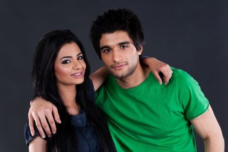 portrait of ethnic couple couple in studio, latin american man with Indian girl photo
