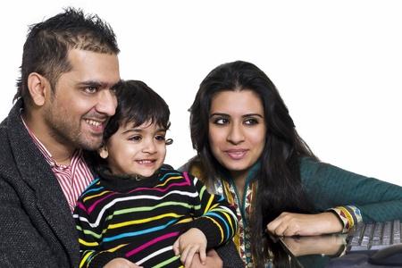 jovial: happy multi ethnic family of three enjoying together