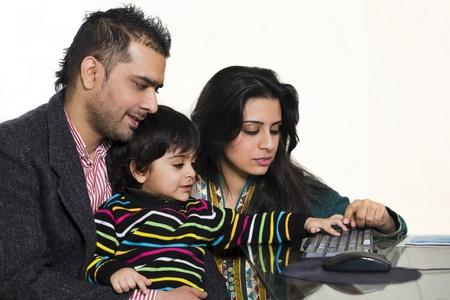 happy multi ethnic family of three enjoying together photo