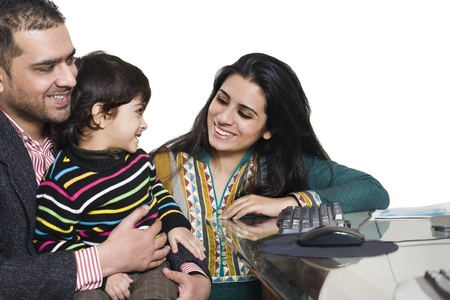 family indoors: happy multi ethnic family of three enjoying together