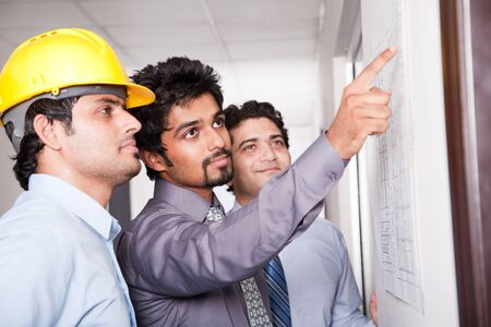businessmen in meeting with architect photo