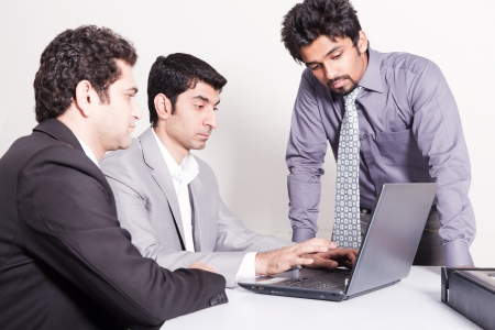 small group of young multiracial businessmen in office meeting photo
