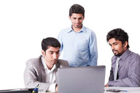 indian business man: small group of young multiracial businessmen in office meeting