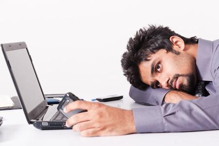 sleeping businessman: portrait of businessman tired after work