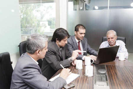 A diversed group of young business executives having a meeting with a senior executive Stock Photo - 14261855